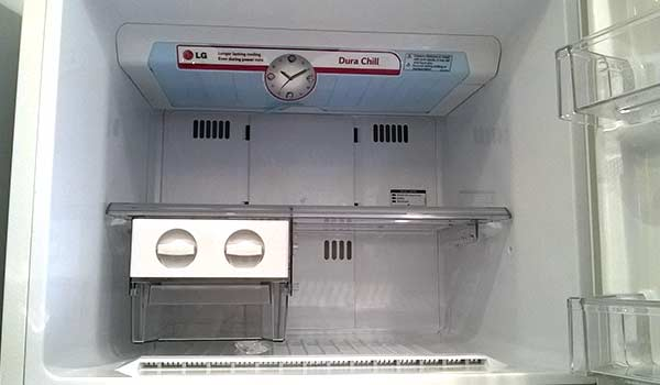 how to put in the ice tray jennair fridge