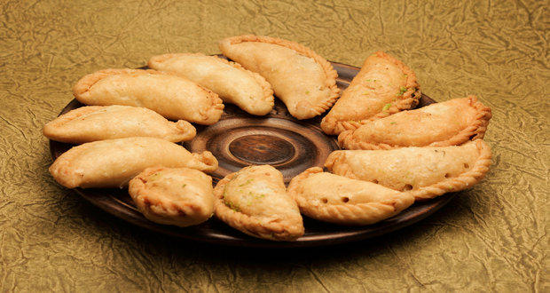 Coconut gujiya recipe ndtv food coconut gujiya forumfinder Choice Image