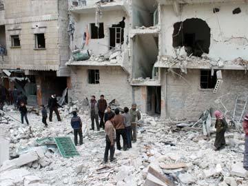 Syrian forces kill 83 in barrel bomb attacks in Aleppo