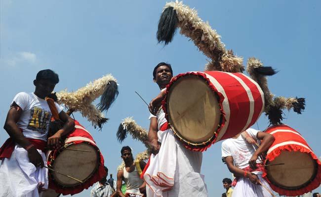 Dhakis during DUrga Puja. Source.