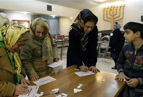 Iran elections: Ahmadinejad rivals leading in parliament vote