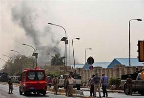 Iraq blasts kill at least 21, say sources