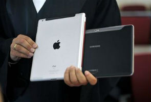 Tech titans faceoff in court over iPhone, iPad