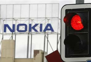 Fitch cuts Nokia to junk, outlook negative