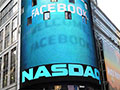 Facebook stumbles in first earnings post-IPO, shares hit new low