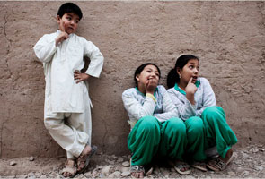 In Afghanistan, boys are prized and girls live the part