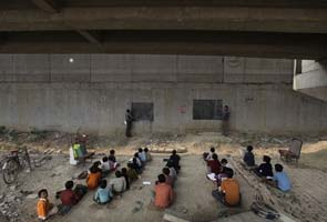 For India's poor, a school under a railway bridge