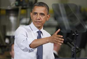 Obama hits out at 'Scrooge' Republicans on tax