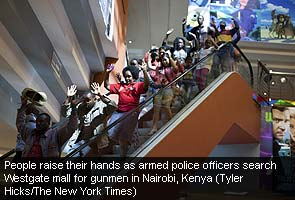 Kenya_mall_attack_people_with_hands_raised_NYT_caption_295.jpg