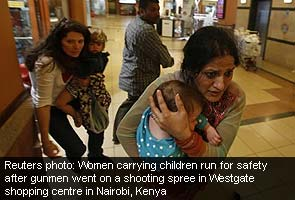 Kenya_mall_attack_women_run_to_safety_Reuters_295.jpg