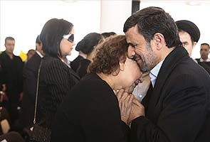 Mahmoud Ahmadinejad under fire for hugging Hugo Chavez's mother
