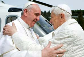 Pope Francis tells Benedict: 'We're brothers'