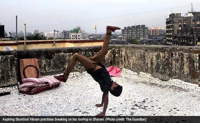 SlumGods_Dharavi_Guardian_650_27Nov14_with_image_caption.jpg