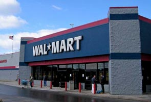 Government clears committee to investigate alleged lobbying by Wal-Mart