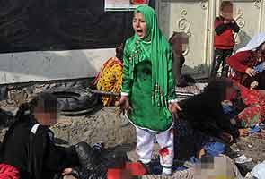 afghan_girl_massacre_ashura_pullitzer_295.jpg