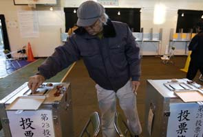 Conservative party favored as Japanese votes