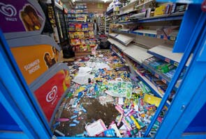 London rioters raid store shelves, target luxury brands