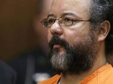 Ariel Castro, right, sits in the courtroom during the sentencing phase ...