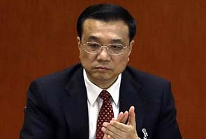 China's new premier pledges reform, sees risks